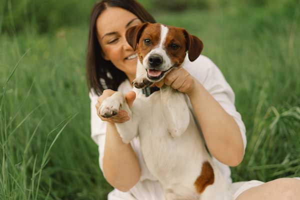 Woman holding a smiling dog